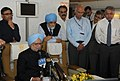 Manmohan Singh addressing the accompanying media onboard on his way back to Delhi after attending the G-20 Summit, in St. Petersburg, Russia. The Deputy Chairman, Planning Commission.jpg