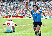 Maradona celebrating the goal. Butcher (6) is seated on the field.