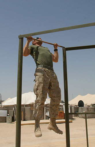 Calisthenics - A US Marine performs a pull-up, a common calisthenic exercise.