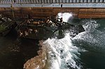 Marines drive an amphibious assault vehicle into the well deck. (36157688336).jpg