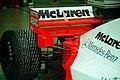Mclaren MP4-10B - Mika Hakkinen in the pit garage at the 1995 British GP, Silverstone (49713026878).jpg