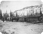Men and horse drawn sled in front of Royal Mail Service office, vicinity of Lake LaBerge, March 14, 1901 (SARVANT 172).jpeg