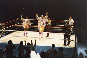 Viscera (wrestler) - Frazier as Mabel (center) with Mo (left) and Oscar (right) as Men on a Mission.