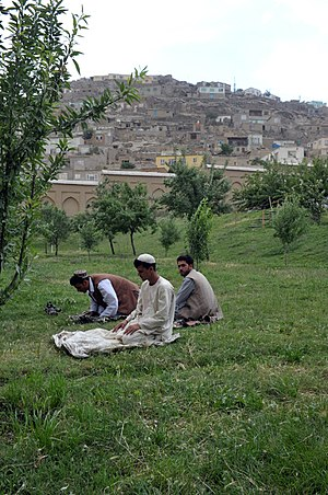 Muslim - Afghan Muslims praying inside Gardens of Babur in Kabul, Afghanistan.