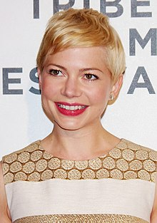 A head shot of Michelle Williams as she smiles looking slightly away from the camera