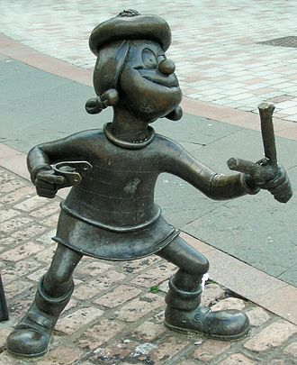Comic book - Statue of Minnie the Minx, a character from The Beano, in Dundee, Scotland. Launched in 1938, The Beano is known for its anarchic humour, with Dennis the Menace appearing on the cover.