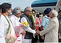 Mohd. Hamid Ansari being received by the Governor of Kerala, Shri Nikhil Kumar, on his arrival at Thiruvananthapuram Airport, Kerala. The Chief Minister of Kerala.jpg