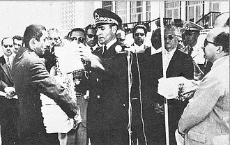 White Revolution - Shah Mohammad Reza Pahlavi hands out documents of ownership of land to new owners, white revolution, land reform, 1963.