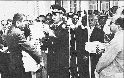 Shah Mohammad Reza Pahlavi hands out documents of ownership of land to new owners, white revolution, land reform, 1963. Mrplandreform1.jpg