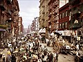 Many people are seen at Manhattan's Little Italy, Lower East Side, circa 1900.