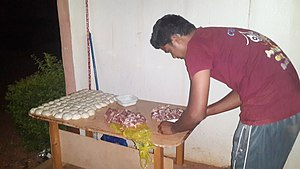 Parotta - Image: Mutton mincing 1