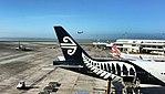 NZ 777 tail with an A320 takeoff (22896736359).jpg