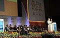 "Narendra Modi addressing the gathering at the ""Invest Madhya Pradesh - Global Investors Summit 2014"", at Indore, Madhya Pradesh. The Chief Minister of Madhya Pradesh, Shri Shivraj Singh Chouhan is also seen.jpg"