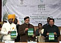 Narendra Modi at the plenary session of National Conference on Sustainable Agriculture & Farmers Welfare, in Gangtok. The Governor of Sikkim, Shri Shriniwas Dadasaheb Patil and the Chief Minister of Sikkim (1).jpg