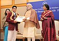 Narendra Modi presenting the National Bravery Awards 2015 to the children, in New Delhi on January 24, 2016. The Union Minister for Women and Child Development, Smt. Maneka Sanjay Gandhi is also seen (1).jpg