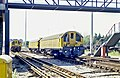 Neasden 1988 Battery Loco 32 and 20 behind.jpg