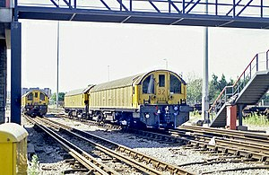 Neasden Depot - Battery electric works locomotives 20, 27, and 32 in sidings at Neasden Depot in 1988.
