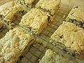 Oatmeal chocolate chip blondies on a wire rack, February 2010.jpg