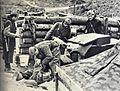Obveščevalci pregledujejo bunkerje in listine po napadu na Štampetov most.jpg