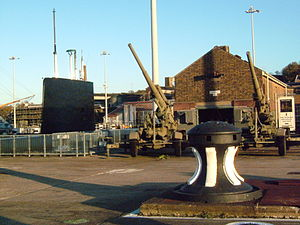 Chatham Historic Dockyard - HMS Ocelot on display, with an anti-aircraft gun to the right as part of a display on the Dockyard and the V1 rocket.