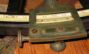 Octant (instrument) - Details on an octant. This photo shows the graduated scale and the end of the index arm with the vernier. The thumbscrew used to lock the index arm position is seen below the index arm while the thumbscrew used for fine adjustment of the arm is on the left. To the right of the value 50 on the main scale, the SBR logo is engraved. The scale is directly graduated in degrees and thirds of a degree (20'). The vernier can divide the 20' intervals to the nearest minute of arc.
