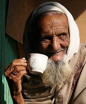 A man drinking tea in Bangladesh on a winter m...