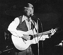 Glen Campbell plays an Ovation guitar.