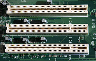 Conventional PCI - Three 5-volt 32-bit PCI expansion slots on a motherboard (PC bracket on left side)
