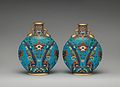 Pair of round, flat bodied bottles MET DP-1687-026.jpg