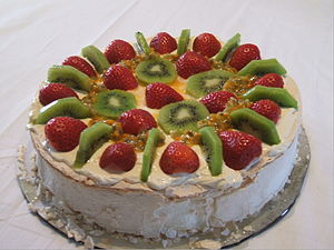 Comfort food - A Pavlova garnished with fruit and cream