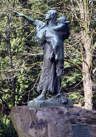 Lewis and Clark Exposition dollar - 1905 statue, Sacajawea and Jean-Baptiste by Alice Cooper, funded using coin proceeds, in Portland's Washington Park