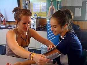 taking blood pressure in PE