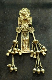Pendant with naked woman. Electrum, Rhodes, ca. 630-620 BCE.