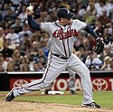 Peter Moylan partway through his pitching motion, wearing the Atlanta Braves road uniform in 2009.