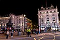 Piccadilly Circus with fountain and buildings by night.jpg