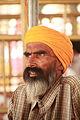 Pilgrim inside the Golden Temple (9690073019).jpg