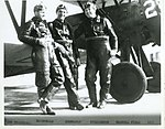 Pilots C.L. Chennault, Bill MacDonald, and Luke Williamson of the The Flying Trapeze pose in front of their stunt plane, a Boeing P-12E.jpg