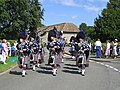 Pipe band arriving - geograph.org.uk - 1398779.jpg