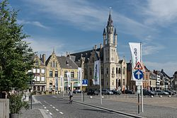 Street banners welcome visitors to Poperinge's Town Hall and Grote Market