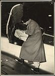 Portrait of Jean Batten studying charts whilst standing on wing of aeroplane, 193-? (16289742645).jpg