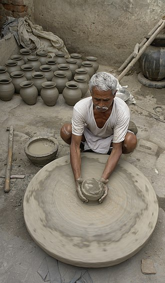 Pottery - A potter at work in Morena, India
