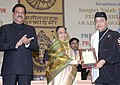 Pratibha Devisingh Patil presenting the Sangeet Natak Akademi Fellow Award-08 to Shri Bhupendra Kumar Hazarika for his outstanding contribution to Indian music.jpg