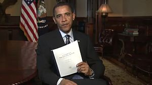 Obama holding the owners' proposal.