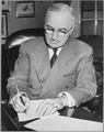President Harry S. Truman is shown at his desk at the White House signing a proclamation declaring a national... - NARA - 541951.tif