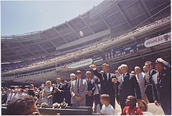 President attends the 32nd All-Star Baseball Game, throws out first ball. Speaker of the House John W. McCormack... - NARA - 194250.jpg