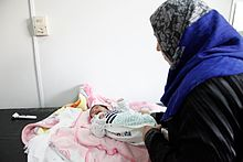 Providing check-ups for newborn children at a Save the Children clinic in Lebanons Bekaa Valley (11174159186).jpg