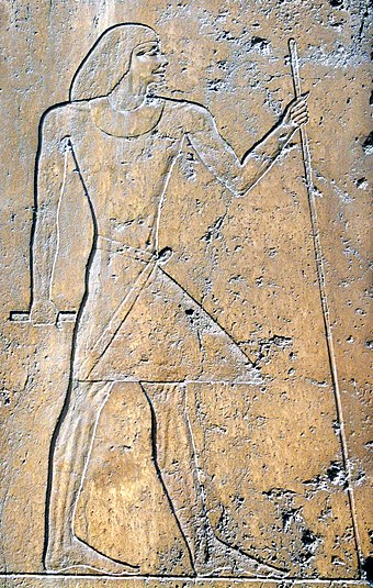 Relief showing Ptahshepses found in his mastaba. Ptahshepses was given the rare honour of kissing Neferirkare's feet. Ptahchepses1a.jpg