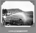 Queensland State Archives 4565 Fire stream at cubicles Stanley River Township c 1936.png