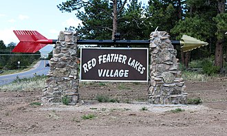 Red Feather Lakes, Colorado - A sign pointing to Red Feather Lakes Village.