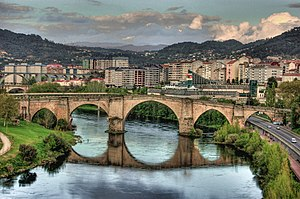Ourense - View of the Roman bridge Ponte Vella, in Ourense that traverses the Miño river